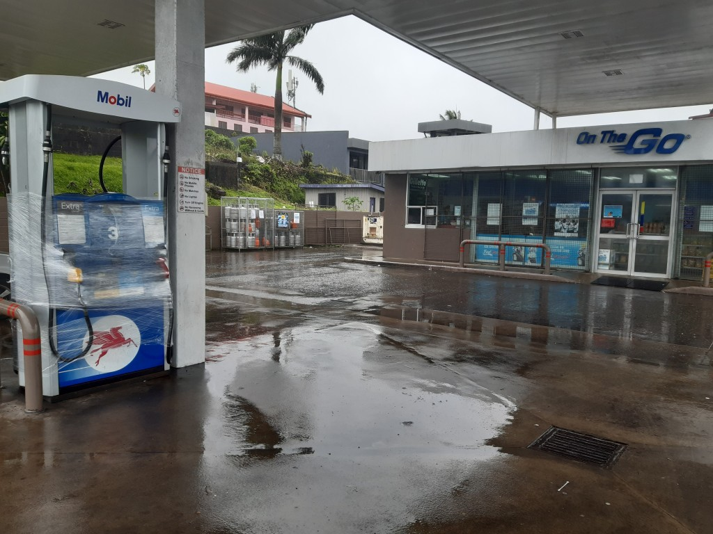 A Mobil gas station shutters its convenience store and gas pumps in preparation for cyclone Yasa in Suva, Fiji, Thursday, Dec. 17, 2020. Fiji was urgi...