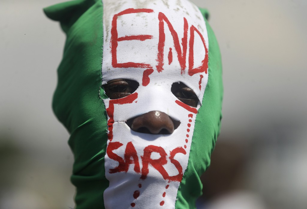 People demonstrate on the street to protest against police brutality, in Lagos, Nigeria, Sunday Oct. 18, 2020. Nigerian protests against police brutal...