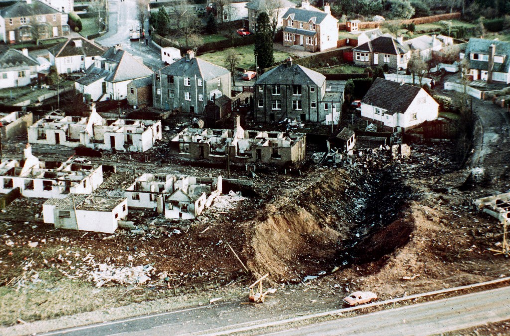 FILE - This December 1988 file photo shows wrecked houses and a deep gash in the ground in the village of Lockerbie, Scotland, after the bombing of th...