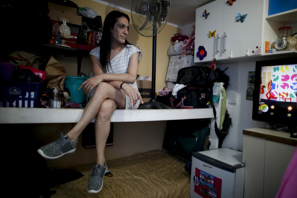 """Transgender woman Gualdalupe Olivares poses for a photo in her room in Buenos Aires, Argentina, Monday, Nov. 16, 2020. """"I think almost 100% of us have..."""