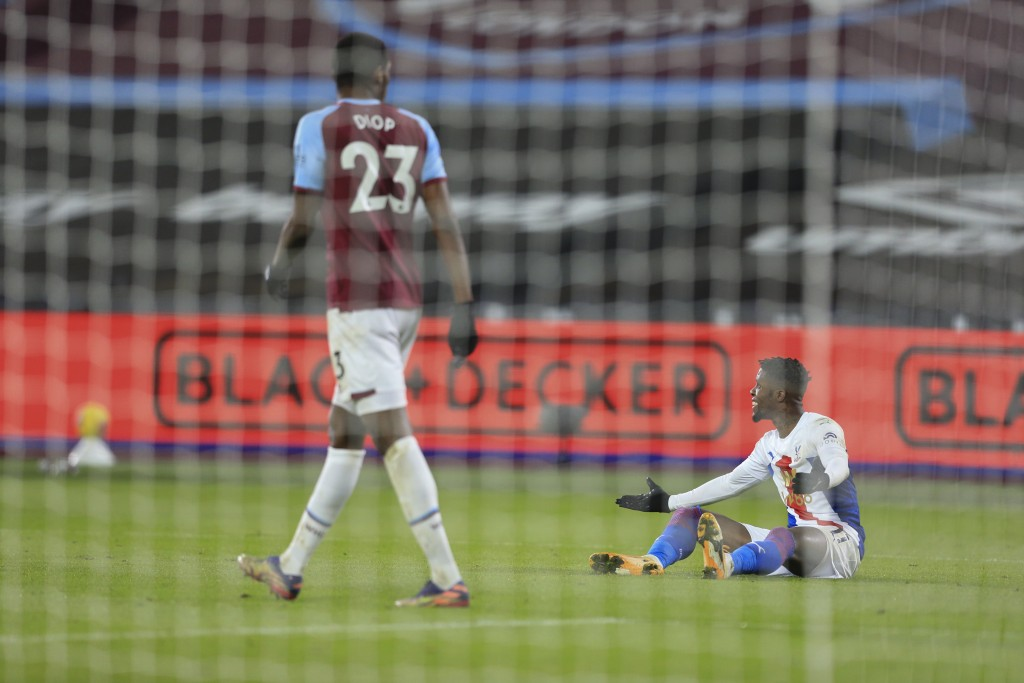 Crystal Palace's Wilfried Zaha appeals for a foul after a tackle in the penalty box during the English Premier League soccer match between West Ham an...