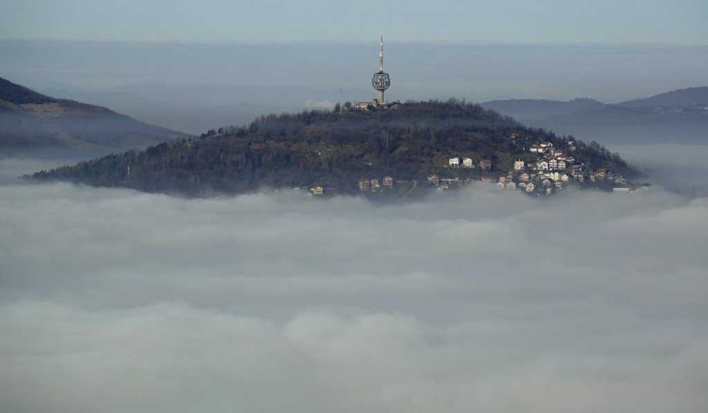 A TV tower is surrounded by fog in the capital Sarajevo, Bosnia, Thursday, Dec. 17, 2020. With the arrival of cold and foggy winter weather, eastern E...