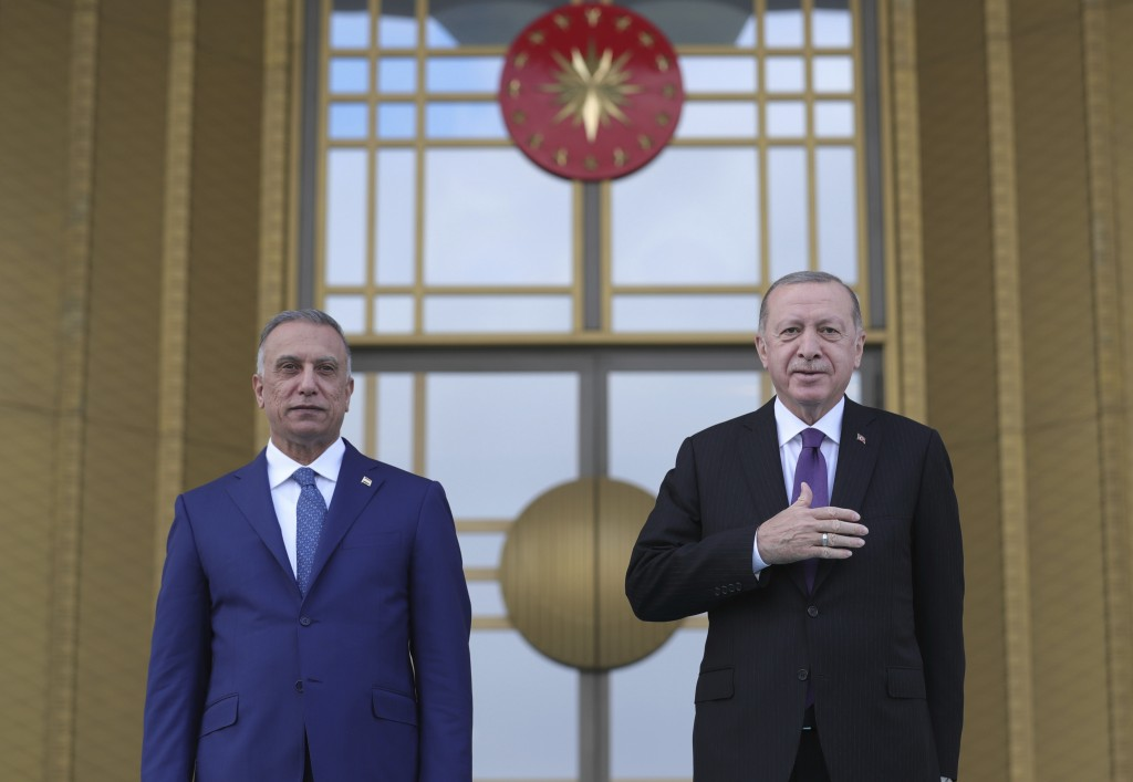 Turkey's President Recep Tayyip Erdogan, right, poses for photographs with Iraqi Prime Minister Mustafa al-Kadhimi, left, during a welcome ceremony pr...