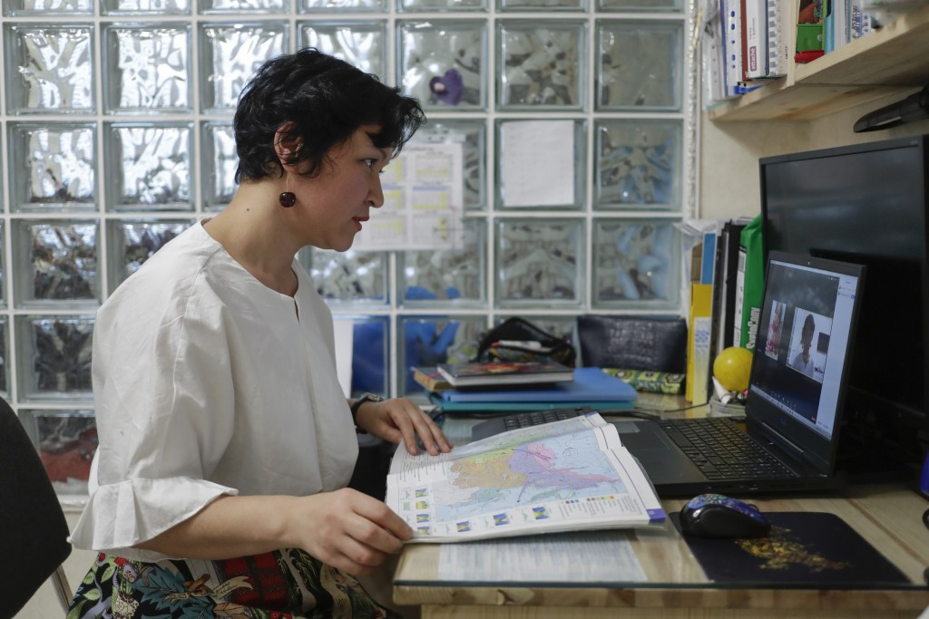 School teacher Dzhamilya Kryazheva leads a remote lesson in Krasnogorsk, outside Moscow, on Friday, Dec. 4, 2020. Kryazheva says she doesn't want to g...