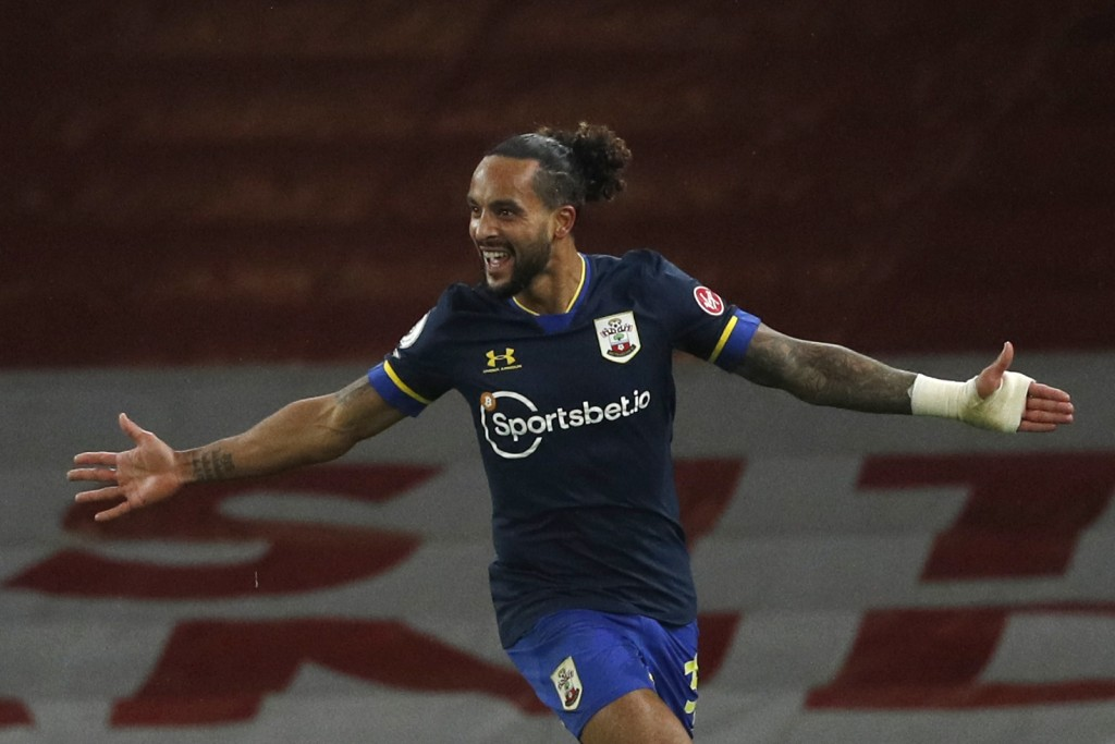 Southampton's Theo Walcott celebrates after scoring his side's first goal during an English Premier League soccer match between Arsenal and Southampto...