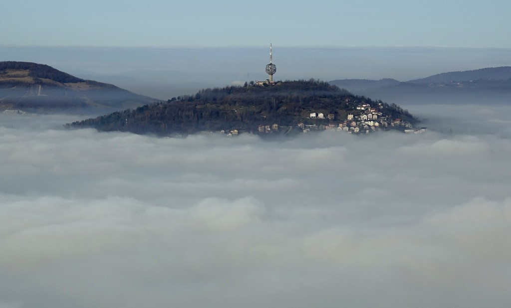 The Bosnian capital of Sarajevo is covered by layers of fog, Thursday, Dec. 17, 2020. With the arrival of cold and foggy winter weather, eastern Europ...