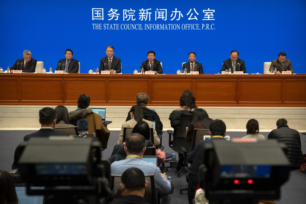 Officials with China's space and lunar exploration programs attend a press conference about the Chang'e 5 lunar lander at the State Council Informatio...