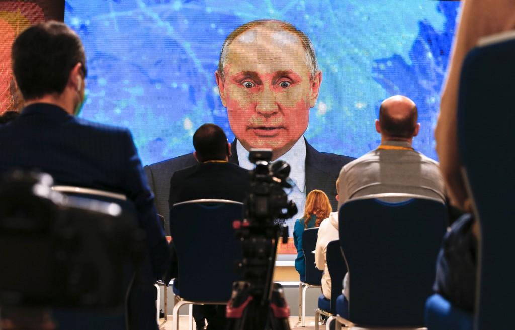 Russian President Vladimir Putin speaks via video call during a news conference in Moscow, Russia, Thursday, Dec. 17, 2020. This year, Putin attended ...
