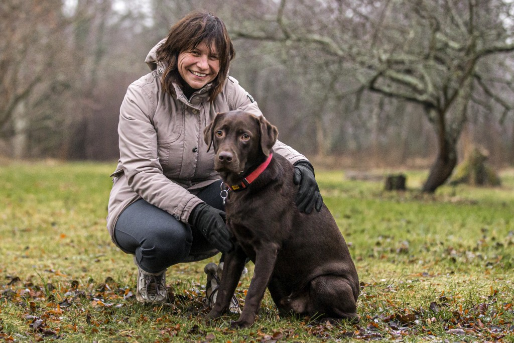 Viktoria Ger poses for a photo with her other dog Walli a back yard of her house, outside Tallinn, Estonia, Wednesday, Dec. 16, 2020. Viktoria Ger, wh...