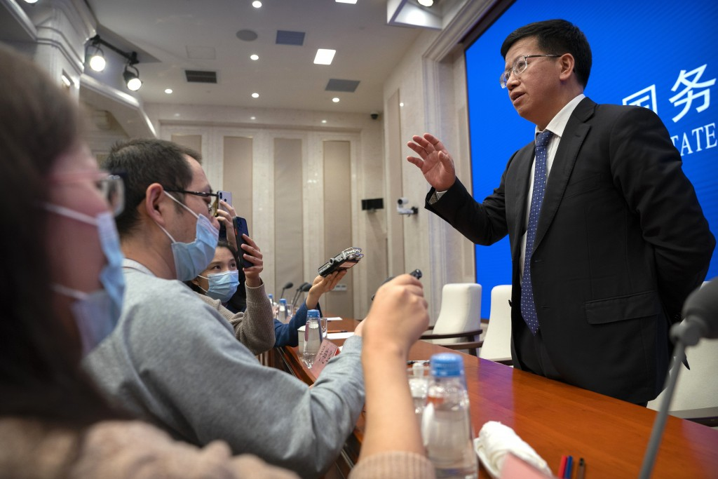 Wu Yanhua, deputy chief commander of the China Lunar Exploration Program, speaks to journalists after a press conference about the Chang'e 5 lunar lan...