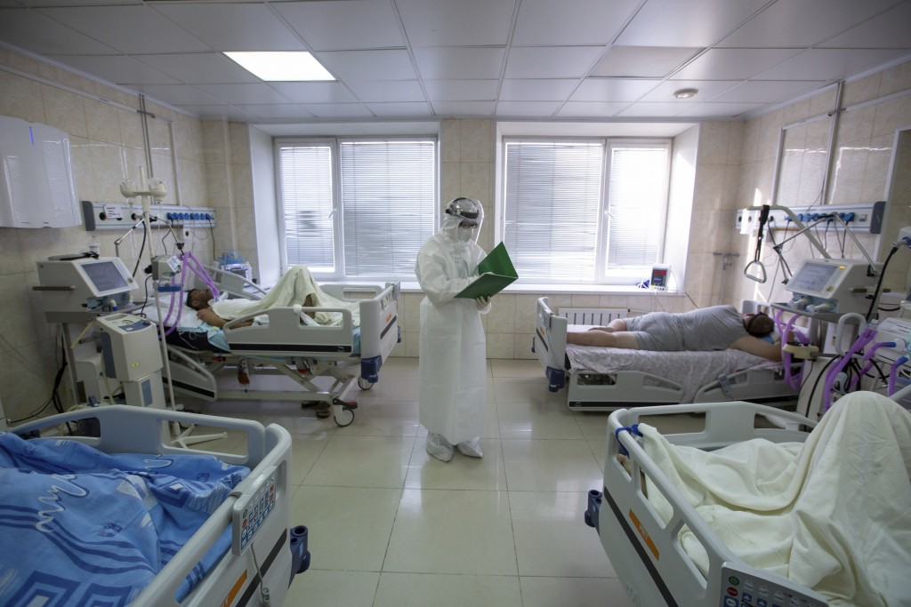 A medical worker stands at an intensive care unit of a hospital in Vladivostok, Russia, on Thursday, Dec. 10, 2020. Russia has recorded more than 2.7 ...