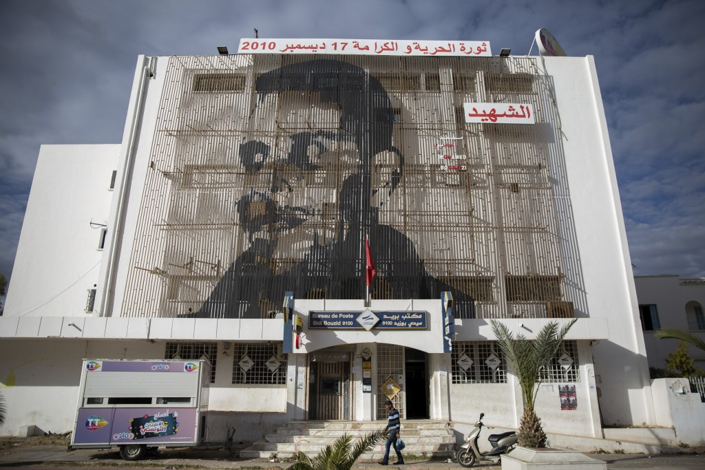 Mohammed Bouazizi is depicted on the facade of post office in Sidi Bouzid, Tunisia, on Friday Dec.11, 2020. Hundreds of desperate Tunisians have set t...
