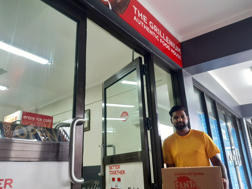 Akshay Kumar, co-owner of the Grillenium Authentic Food House, tests out delivery service in the preparation for cyclone Yasa in the Samabula neighbor...