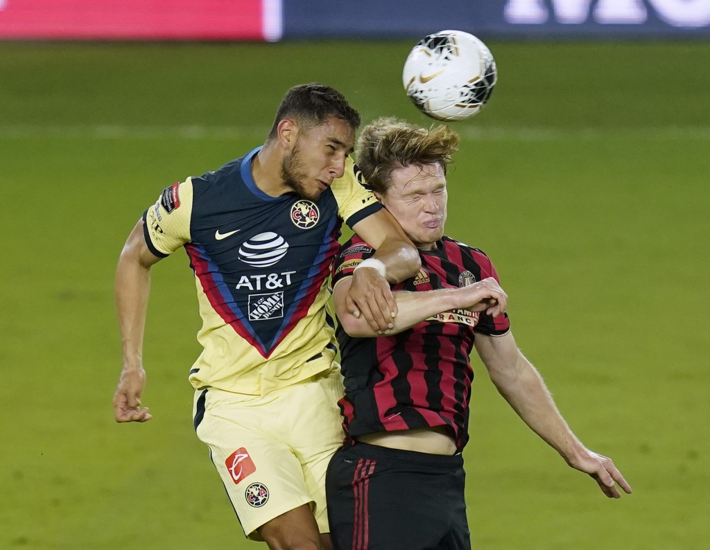 Club America defender Sebastian Caceres, left, and Atlanta United midfielder Jackson Conway go up for a header to control the ball during the second h...