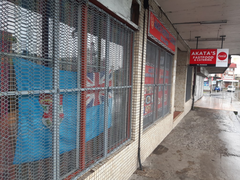 A fast-food store is closed in the preparation for cyclone Yasa in the Samabula neighborhood of Suva, Fiji, Thursday, Dec. 17, 2020. Fiji was urging p...