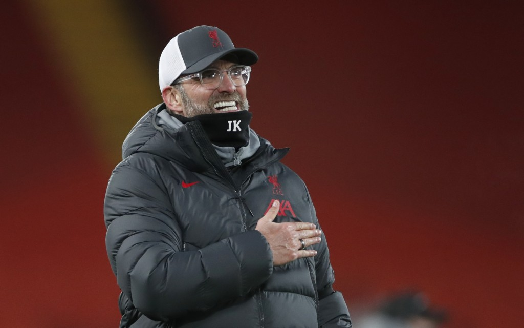 Liverpool's manager Jurgen Klopp celebrates towards the fans after the end of the English Premier League soccer match between Liverpool and Tottenham ...