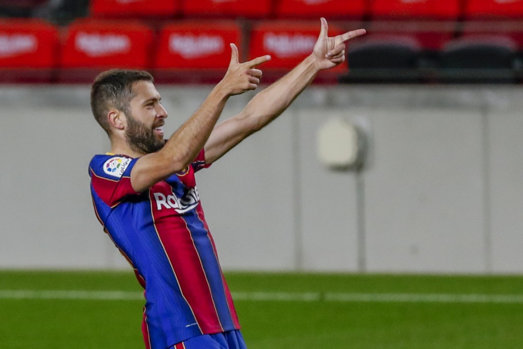 Barcelona's Jordi Alba celebrates after scoring his side's first goal during the Spanish La Liga soccer match between FC Barcelona and Real Sociedad a...
