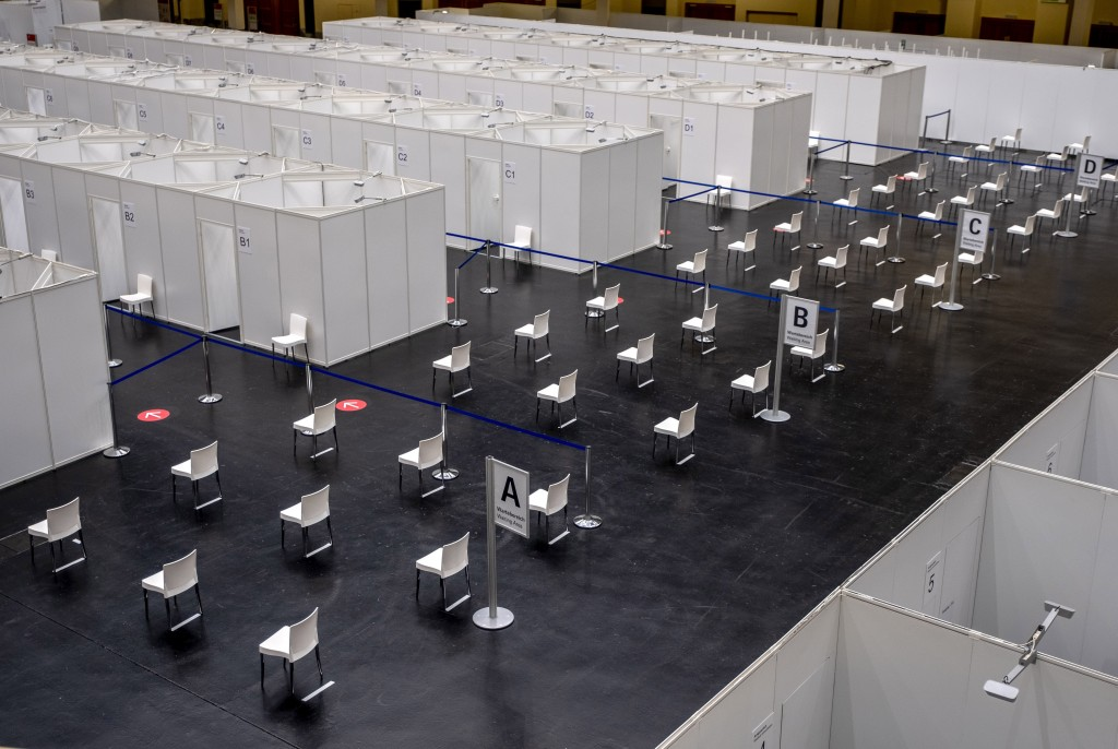 Chairs are lined up in in the Festhalle in Frankfurt, Germany, during the introducing of a vacciantion center on Thursday, Dec. 17, 2020. German state...