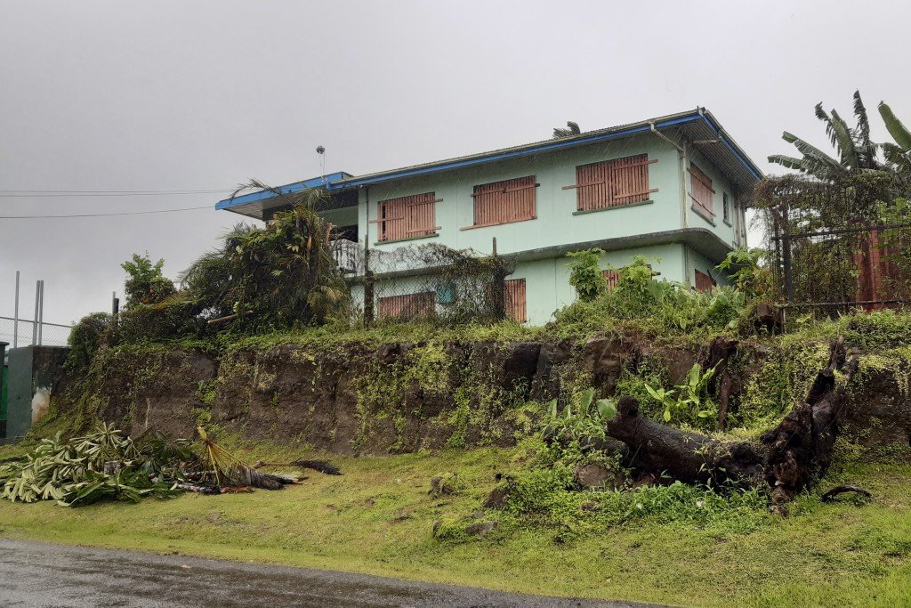A house is shuttered in the preparation for cyclone Yasa in the Tamavua neighborhood of Suva, Fiji, Thursday, Dec. 17, 2020. Fiji was urging people ne...