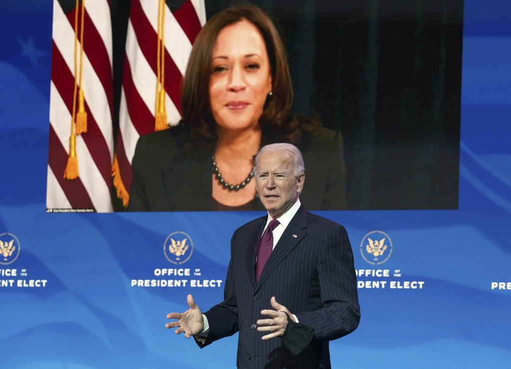 President-elect Joe Biden speaks as Vice President-elect Kamala Harris looks on via video during a news conference at The Queen theater in Wilmington,...