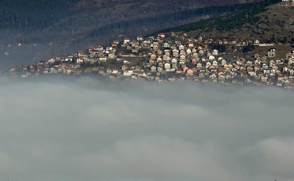 The Bosnian capital of Sarajevo is covered by layers of fog, Bosnia, Thursday, Dec. 17, 2020. With the arrival of cold and foggy winter weather, easte...