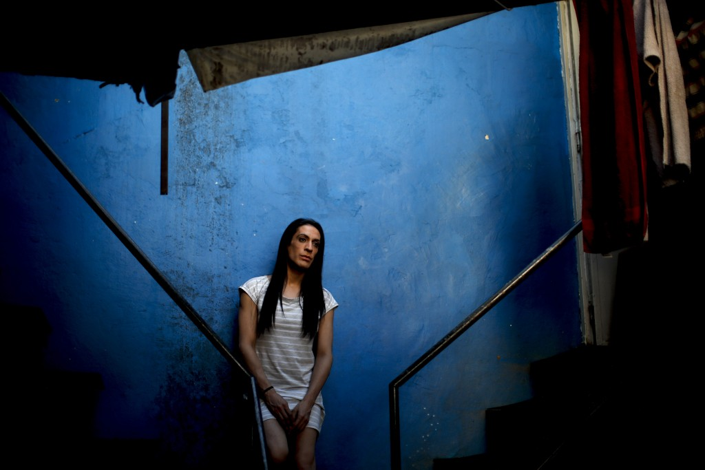 Transgender woman Guadalupe Olivares poses for a photo at the hotel where she lives in Buenos Aires, Argentina, Monday, Nov. 16, 2020. Olivares had a ...