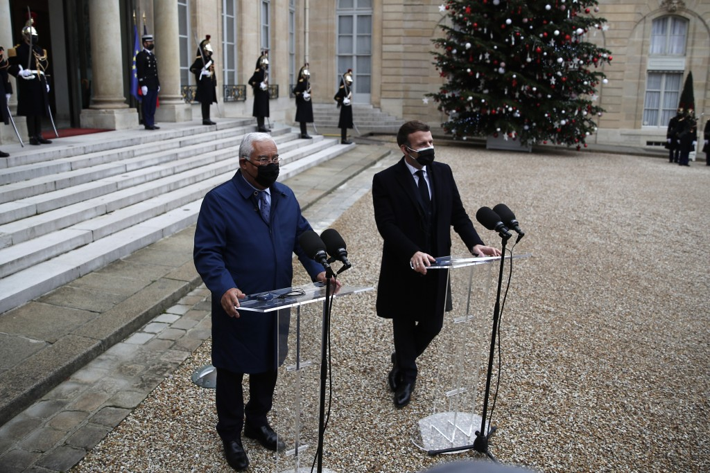 French President Emmanuel Macron, right, and Portuguese Prime Minister Antonio Costa answer reporters, Wednesday, Dec. 16, 2020 in Paris. French Presi...
