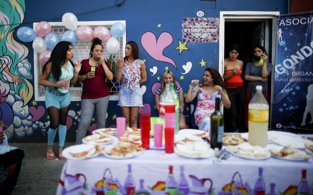 Transgender women celebrate Pride Day at the Hotel Gondolin where they live in Buenos Aires, Argentina, Saturday, Nov. 7, 2020. In September, Presiden...