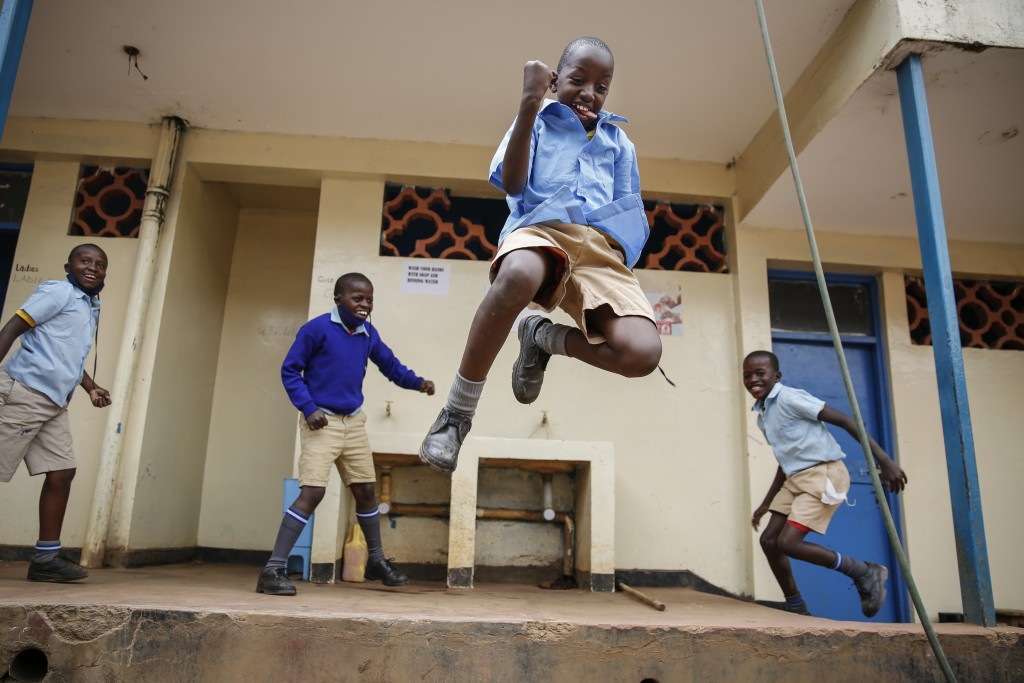 Schoolchildren joke around and play at the Olympic Primary School in Kibera, one of the capital Nairobi's poorest areas, in Kenya Monday, Oct. 12, 202...