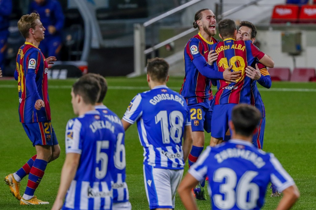 Barcelona's Jordi Alba, second right, celebrates after scoring his side's first goal during the Spanish La Liga soccer match between FC Barcelona and ...