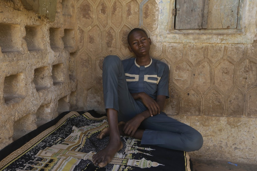 Usama Aminu, 17 year-old, a kidnapped student of the Government Science Secondary School who escaped from bandits is seen during an interview with The...