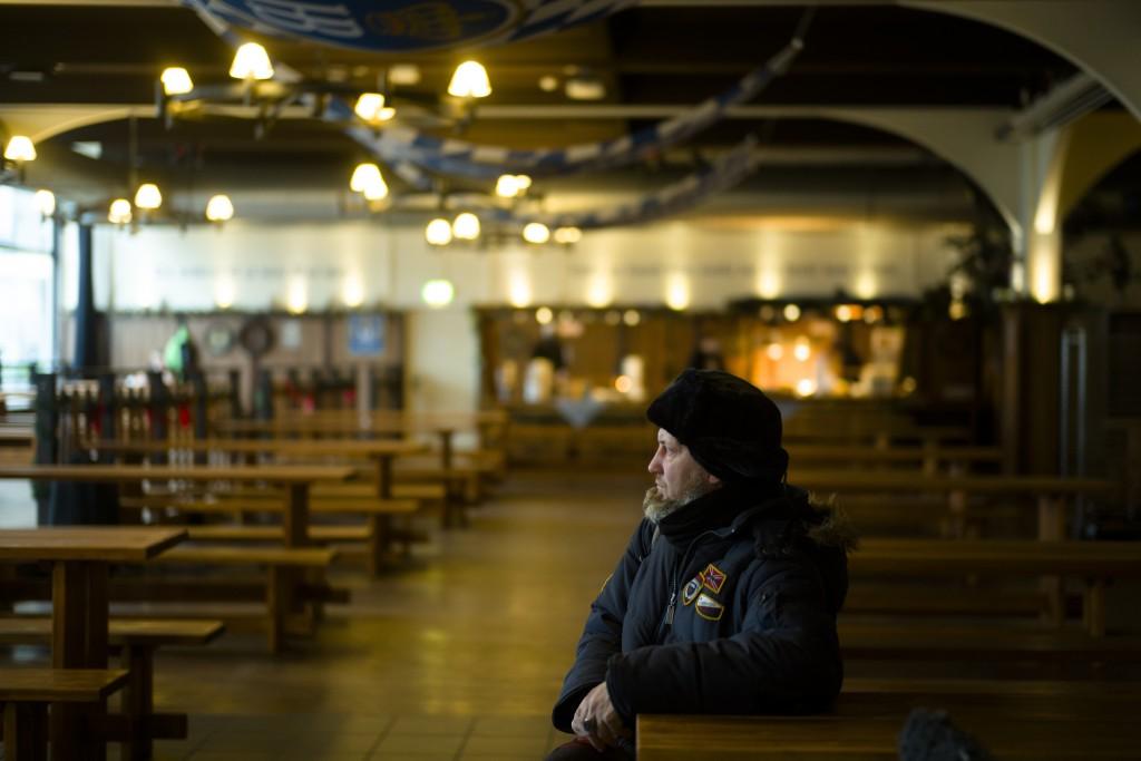 Homeless man Kaspars Breidaks from Latvia sits in guest room of Berlin's biggest restaurant Hofbraeu Berlin, in Berlin, Germany, Thursday, Dec. 17, 20...