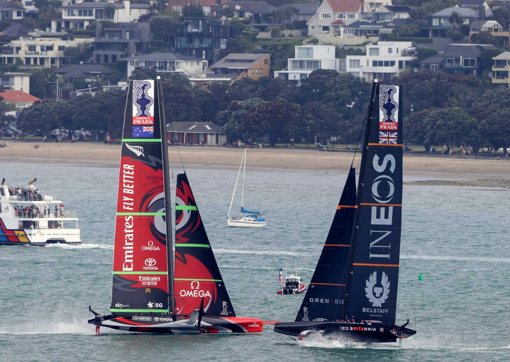 Team New Zealand yacht, left, and Britain's Team UK compete in the America's Cup World Series on the Hauraki Gulf off Auckland, New Zealand, Friday, D...