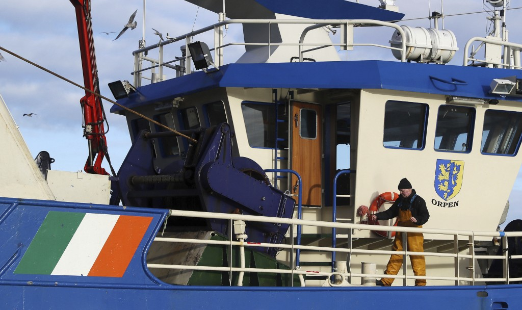 A fisherman aboard a vessel after docking in the fishing village of Howth, Dublin, Ireland, Thursday, Dec. 17, 2020. Irish coastal communities will be...