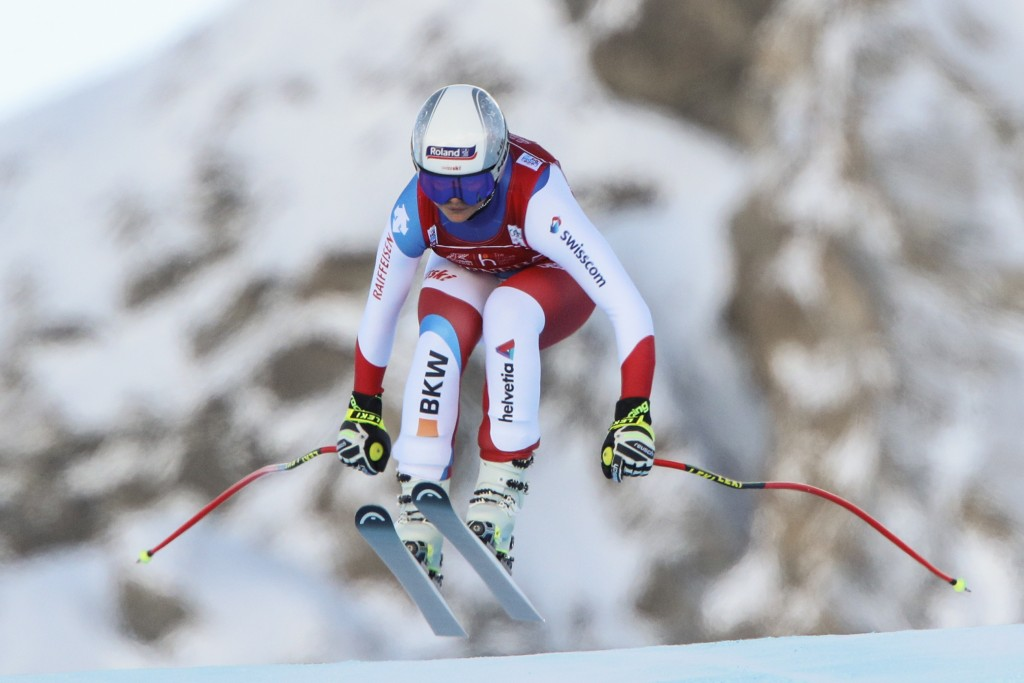 Switzerland's Corinne Suter speeds down the course during an alpine ski, women's World Cup Downhill, in Val d'Isere, France, Friday, Dec.18, 2020. (AP...