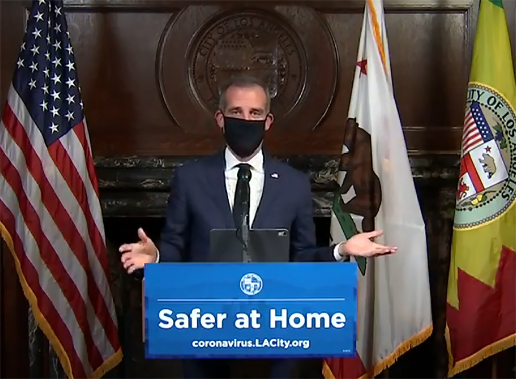 FILE - This April 2, 2020 file still image taken from a live stream provided by Office of the Mayor shows Los Angeles Mayor Garcetti with a protective...