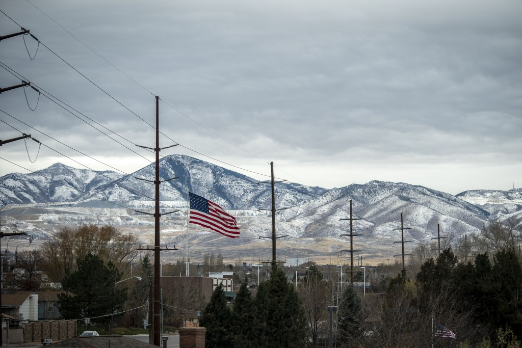 A U.S. flag flies against the mountains in Bountiful, Utah, Sunday, Nov. 15, 2020. Founded by believers in what was then a small, fringe religion, Uta...