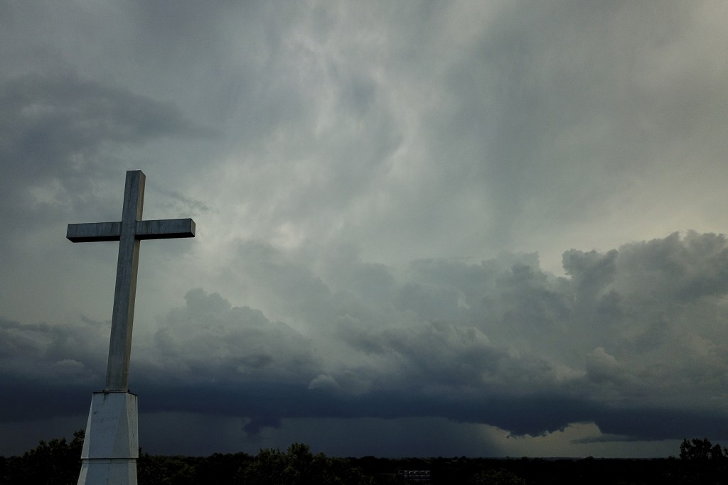 FILE - In this Sunday, Aug. 2, 2020 file photo, a storm cloud approaches the Mequon Untited Methodist Church in Mequon, Wis. The coronavirus pandemic ...