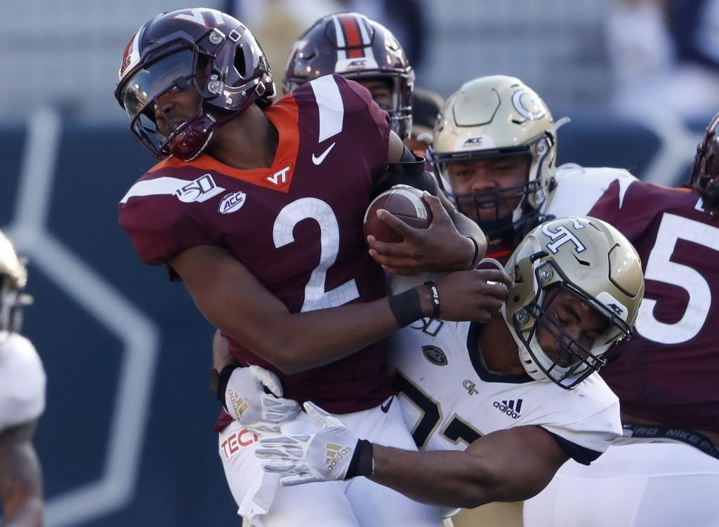 FILE - In this Saturday, Nov. 16, 2019 file photo, Virginia Tech quarterback Knox Kadum (12) is stopped by Georgia Tech defensive lineman Sylvain Yond...