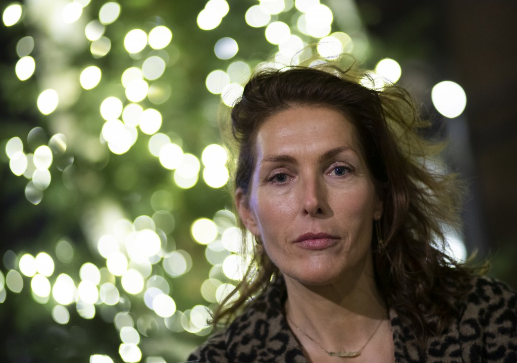 Former model Thysia Huisman, who is among women who have accused Jean-Luc Brunel of rape, poses for a picture in Amsterdam, Netherlands, Thursday, Dec...