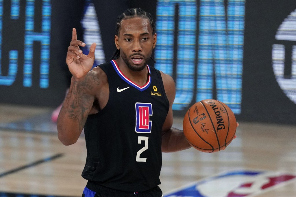 FILE - Los Angeles Clippers' Kawhi Leonard (2) gestures in the second half of an NBA conference semifinal playoff basketball game against the Denver N...