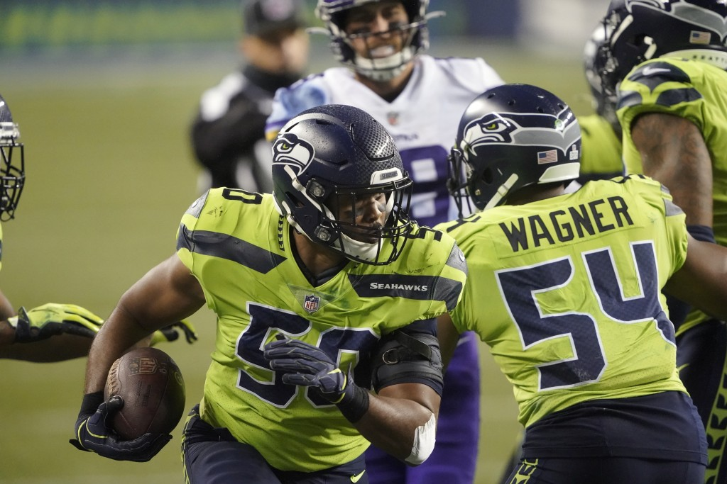 FILE - In this Sunday, Oct. 11, 2020, file photo, Seattle Seahawks' K.J. Wright runs with the ball after recovering a Minnesota Vikings fumble during ...