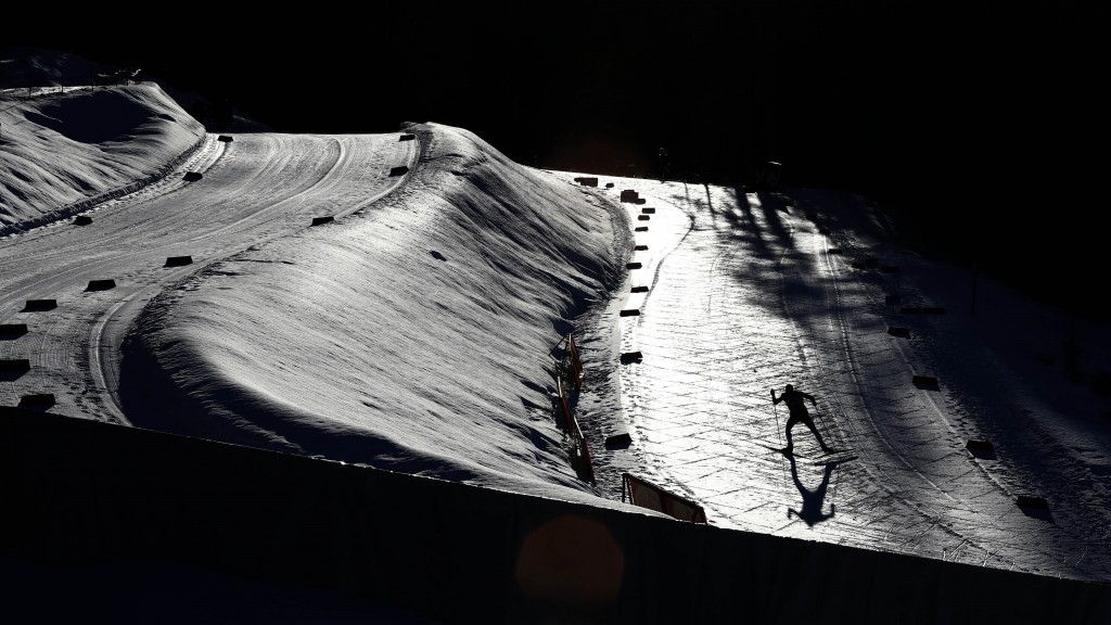 An athlete warms up for the Nordic Combined World Cup Men's Individual Gundersen NH/5km competition in Seefeld, Austria, Friday, Jan. 31, 2020. (AP Ph...