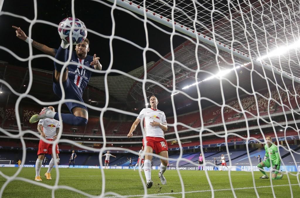 PSG's Neymar follows the ball into the net after Juan Bernat scored his side's third goal during the Champions League semifinal soccer match between R...