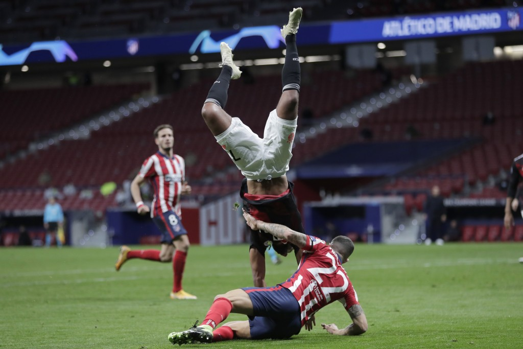 Atletico Madrid's Mario Hermoso, right, fights for the ball with Bayern's Serge Gnabry during the Champions League group A soccer match between Atleti...