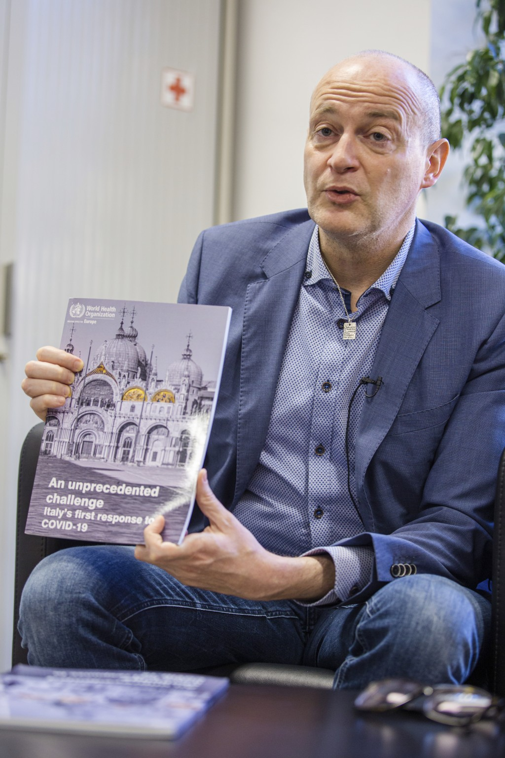 Francesco Zambon, lead author of a withdrawn WHO report into Italy's coronavirus response shows his report during an interview with The Associated Pre...