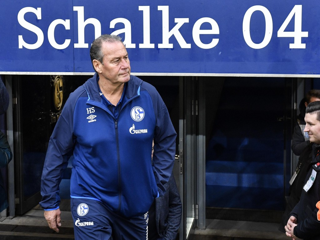 FILE - In this Saturday, March 16, 2019 file photo Schalke's then interims coach Huub Stevens arrives at the arena prior to the German Bundesliga socc...