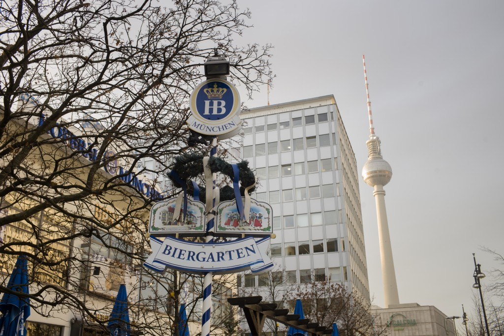 The entrance sign of Hofbraeu Berlin is seen in front of Berlin's biggest restaurant, with the television tower in the background in Berlin, Germany, ...