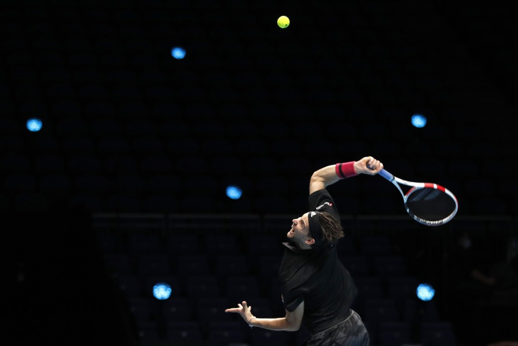 Dominic Thiem of Austria serves to Daniil Medvedev of Russia during their singles final tennis match at the ATP World Finals tennis tournament at the ...