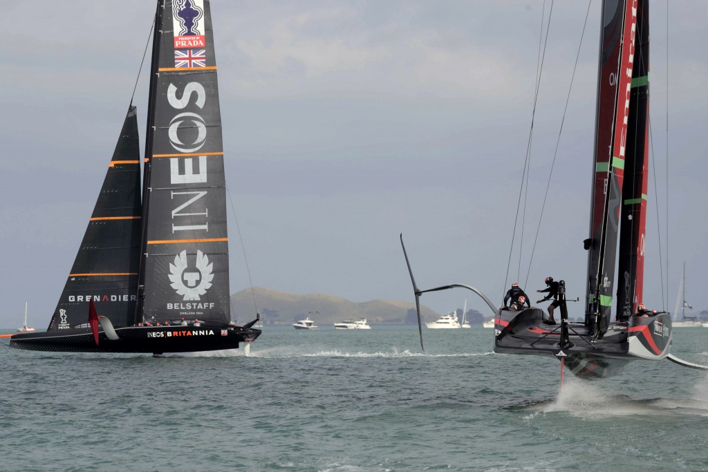 Team New Zealand yacht, right, and Britain's Team UK compete in the America's Cup World Series on the Hauraki Gulf off Auckland, New Zealand, Friday, ...